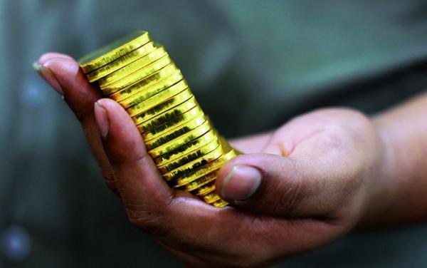Для чего стоит покупать золото в банке